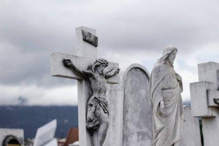 Stone crucifix statue