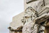 Stone sculpted Crucifix