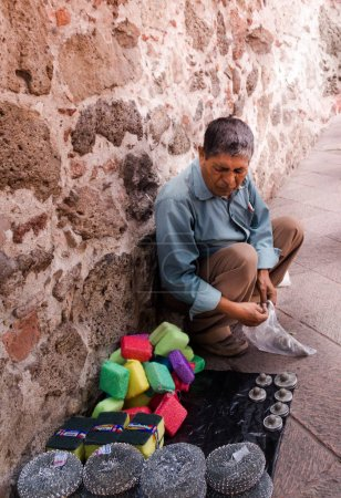 Mexican man selling handcrafts and other objects
