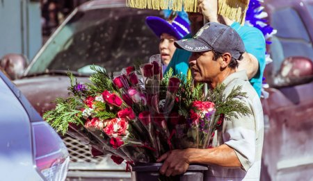 Man selling roses photograph