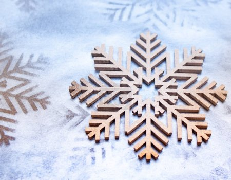 Closeup detailed shot of wooden snowflake symbol, Christmas holiday background