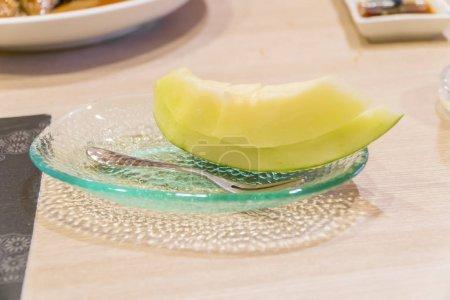 Juicy slice cantaloupe melon on ceramic dish
