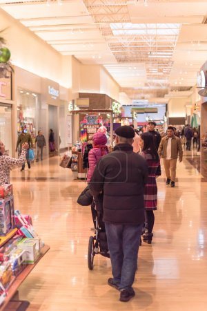 Photo for GRAPEVINE, TEXAS, US-NOV 29, 2019: Crowded of diverse people shoppers at Grapevine Mills mall during Black Friday weekend shopping event. Diverse-scale market place in Dallas-Fort Worth Metroplex - Royalty Free Image