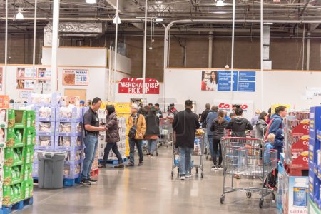 Photo for LEWISVILLE, TEXAS, USA-NOV 29, 2019: Long queue of customer waiting at checkout line on Black Friday and long holiday weekends shopping event at Costco Wholesale in America. - Royalty Free Image