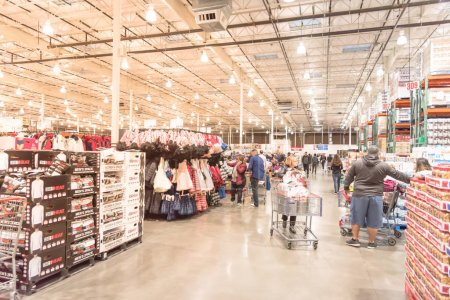 Photo for LEWISVILLE, TEXAS, USA-NOV 29, 2019: Clothes department with diverse customer browsing clothing products on sale on Black Friday at Costco Wholesale. - Royalty Free Image