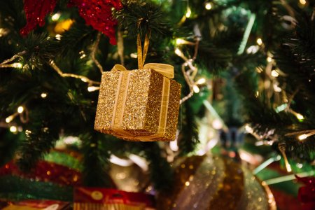Photo for Beautiful decorated Christmas tree background with gold gift box and xmas ornaments - Royalty Free Image