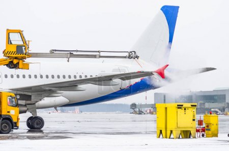 Airport in winter Deicing of the airplane departire