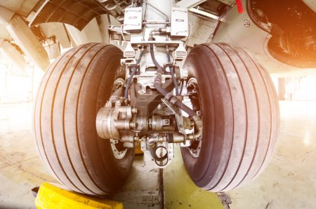 Landing gear airplane in hangar chassis rubber close-up