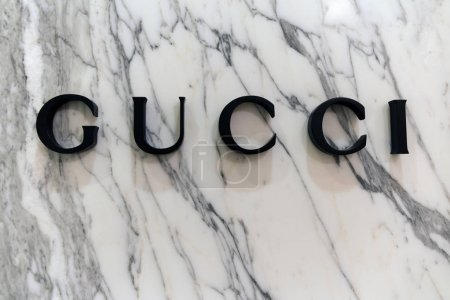 Letters Gucci on a marble