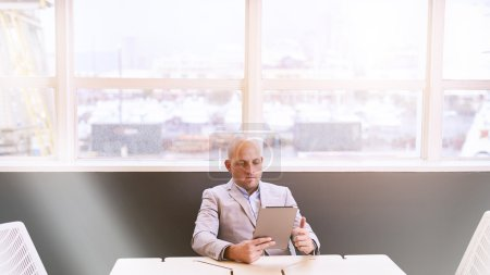 Business man holding and using a high tech tablet