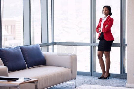 full body image of confident black businesswoman in business lounge