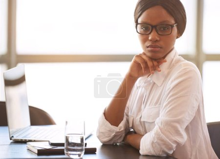 Black businesswoman looking into camera with confident facial expression