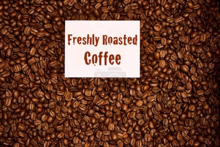 Top Down of coffee beans with freshly roasted coffee sign