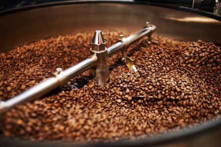 Coffee beans mixing in cooling drum after being freshly roasted