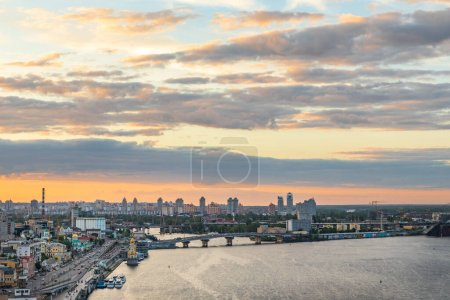 Photo for View to Podil district of Kyiv city from the Pedestrian Bridge at sunset. - Royalty Free Image