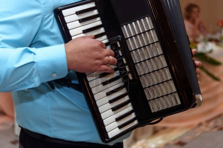 happy accordion musician playing