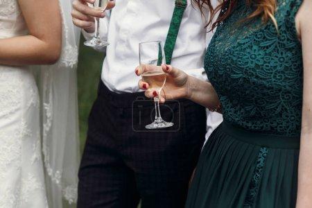 stylish wedding couple toasting