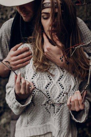 stylish hipster couple hugging