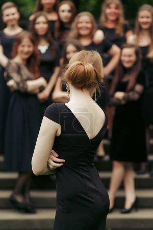 back of lady in black dress