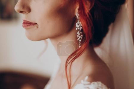 Stylish bride detail, luxury earring and red hair curl, beautifu