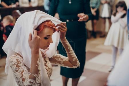 Bride praying in church