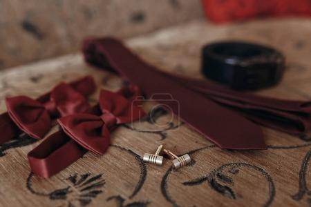 red bow-ties and tie with belt