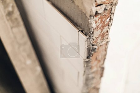 modern ceramic white tiles on wall, renovation concept.