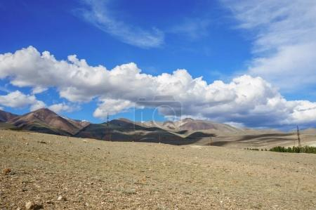 Clouds over Altai steppe and mountains in summer