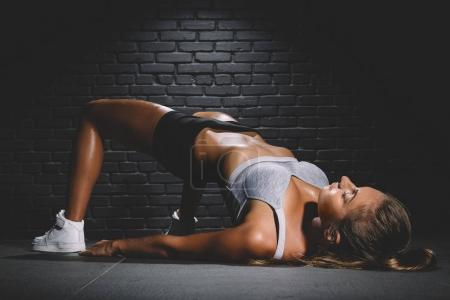 Photo for Woman exercising l workout posture in fitness club - Royalty Free Image
