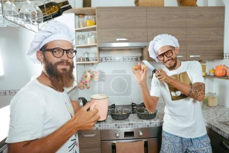 Photo for Food and people concept - happy male chef cook baking over kitchen background - Royalty Free Image