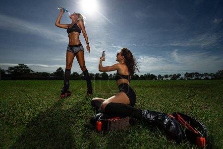 Two girls doing break time of exercises in kangoo ...