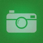 Digitální foto kamery znamení. bílá ikona na zelené pletené nebo w