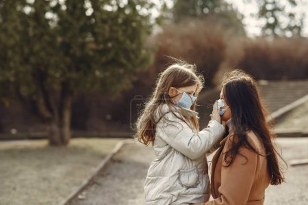 Photo for Family walks outside. Coronavirus theme. Mother with daughter. - Royalty Free Image