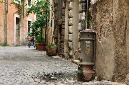 Antique street faucet drinking fountain in Italy
