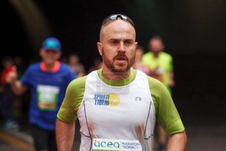 Athlete runs marathon, half-length.
