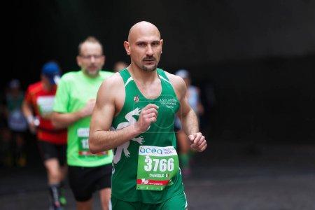 Athletes run the marathon, half-length, bald head