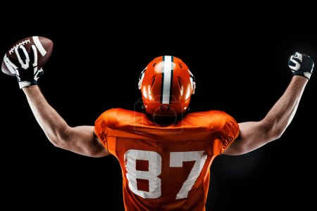 Photo for American football sportsman player on black background - Royalty Free Image