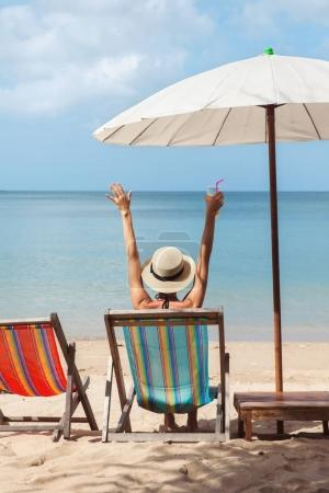 Photo for Vacation holidays. Woman on a tropical beach with hat - Royalty Free Image