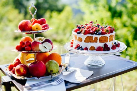 Photo for Fancy fruit cake. Top view. Delicious fruit plate outdoors. Fine art style - Royalty Free Image