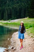 woman relax in pine forest and lake