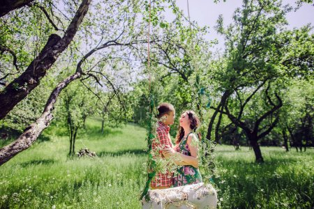 Photo for Vintage love story couple. couple relax in green meadow and garden. Swing background. - Royalty Free Image