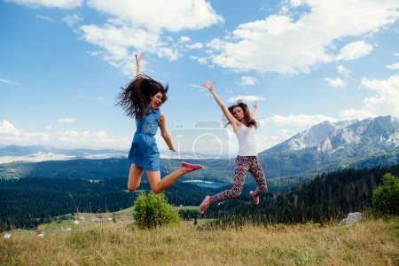 happy women travel and jump together