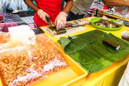 Muslim shoppers buying food from street vendor for breaking fast