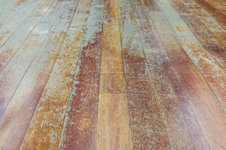 Damaged seasoned wooden floor plank with scratch marks needs res