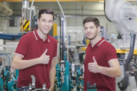 two engineers show thumbs up