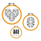Needlework design on embroidery hoops