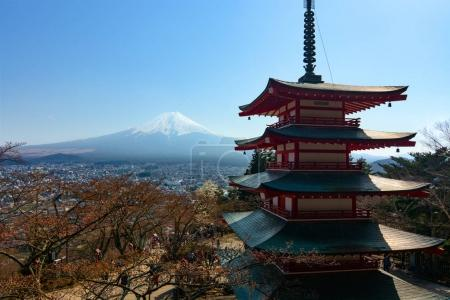 The famous five-storied Chureito Pagoda stands in front of Mount Fuji on a warm spring day in Japan