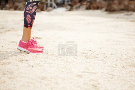 woman runner in pink running shoes