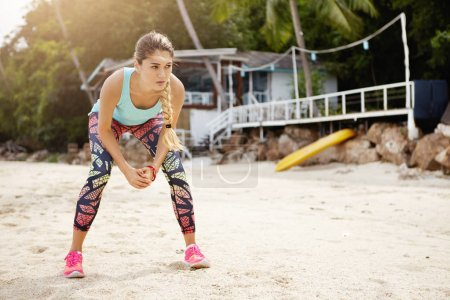 female athlete having rest on beach