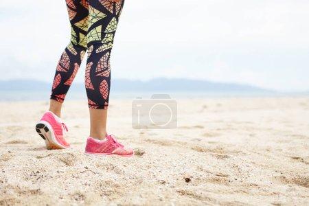 girl athlete against ocean beach